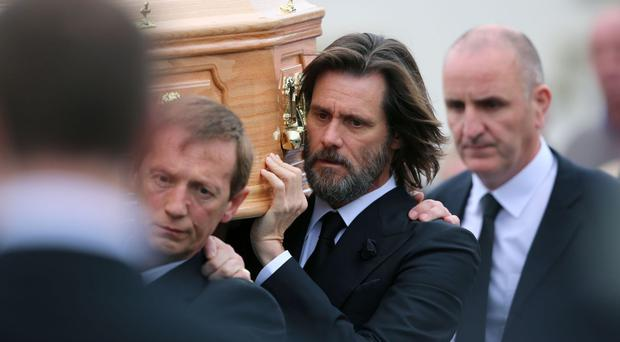 Jim Carrey carries the coffin of ex-girlfriend Cathriona White ahead of her funeral in Co Tipperary