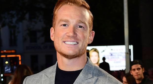 Greg Rutherford said he was 'just chuffed I didn't go out in the first week'