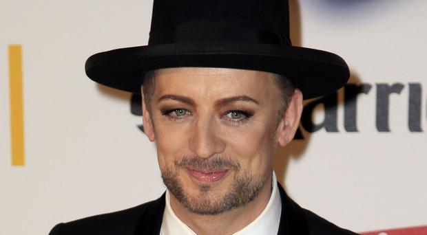 Boy George, who has paid tribute to David Bowie during a performance of the late musician's hit Starman.