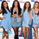 Little Mix are celebrating scoring their fourth number one single with break-up anthem Shout Out To My Ex