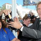 Hugh Laurie signs autographs for fans at a ceremony honoring him with a star on the Hollywood Walk of Fame.