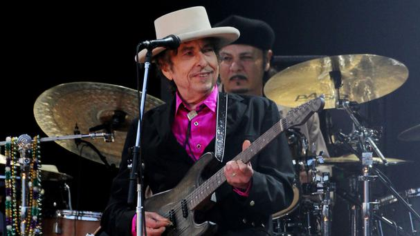 Bob Dylan said he would attend the awarding of his Nobel Prize if he could