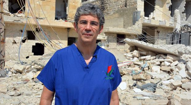 David Nott won the Pride of Britain Special Recognition award for taking several unpaid leave every year for the past 23 years from his job as an NHS surgeon to work as a volunteer for aid agencies (Channel 4/PA)