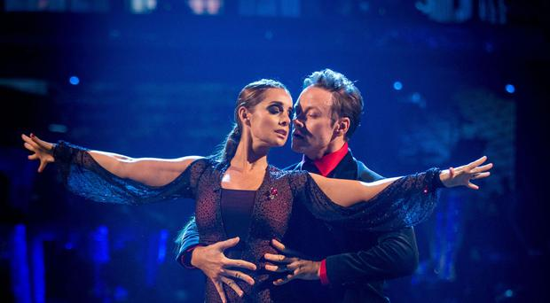 For use in UK, Ireland or Benelux countries only Undated BBC handout photo of Louise Redknapp and her dance partner Kevin Clifton during dress rehearsals for the BBC1 show, Strictly Come Dancing, as Redknapp flew to the top of the scoreboard after earning three 10s for her Argentine Tango, the first of the series.