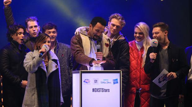 Craig David pushes the button for the switch-on of the Oxford Street Christmas lights