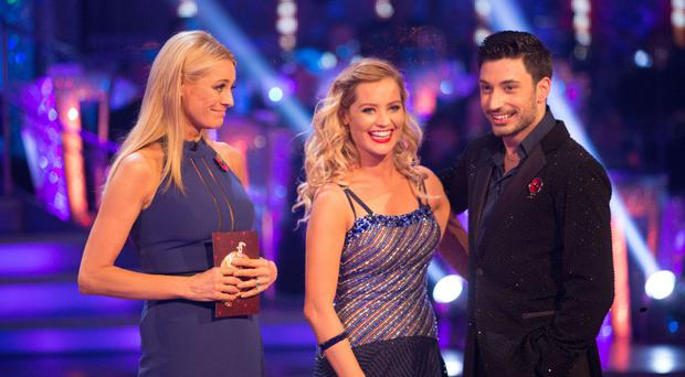 Laura Whitmore and Giovanni Pernice with presenter Tess Daly on Strictly Come Dancing (BBC/PA)