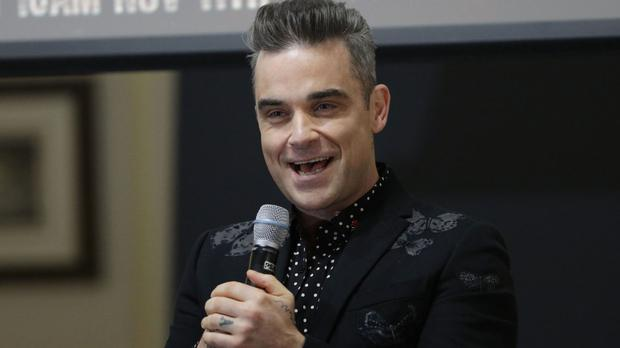 Robbie Williams joked he would try to emulate Donald Trump's strategy of repetition