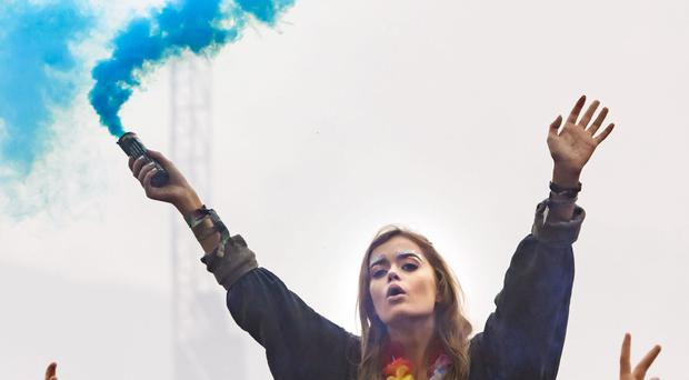 Coloured smoke flares are set off during the Leeds Festival