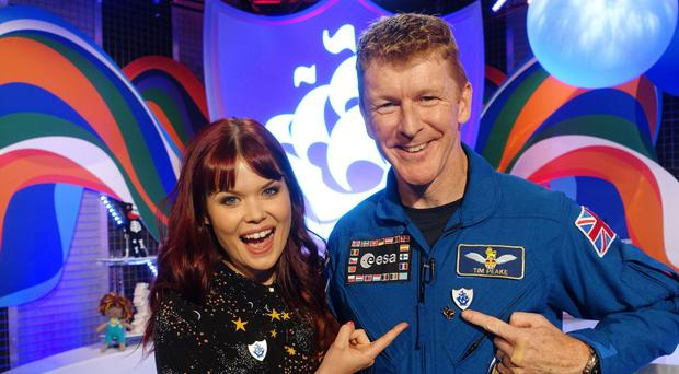 A Tim Peake, right, received a Gold Blue Peter badge for