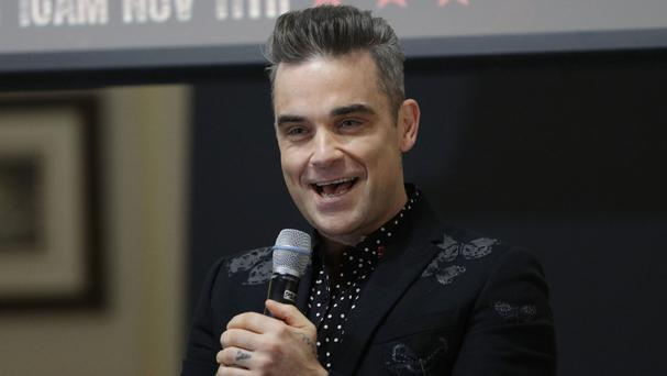 Robbie Williams has now recorded 12 albums to hit the number one spot in the charts