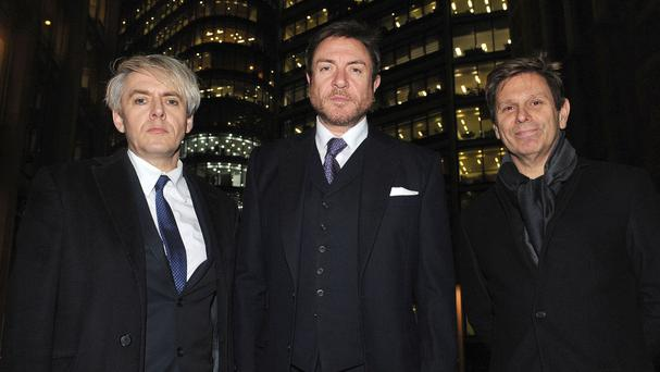 Nick Rhodes, Simon Le Bon and Roger Taylor leave the Rolls Building in central London after a US copyright hearing