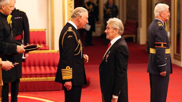 David Mills is made an MBE by the Prince of Wales during an Investiture ceremony at Buckingham Palace