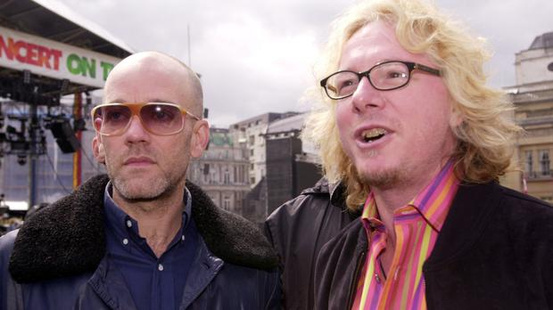 Lead singer of R.E.M Michael Stipe (left) with Mike Mills.