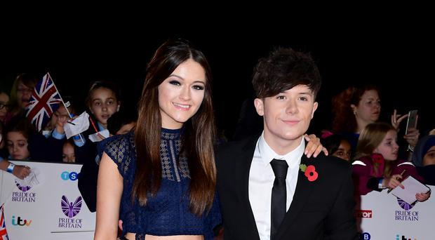 Ryan Lawrie wants girlfriend Emily Middlemas to win the X Factor after he was kicked off the show.