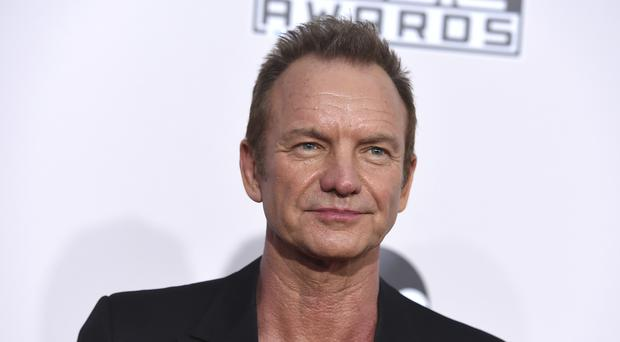 Sting arrives at the American Music Awards (AP)