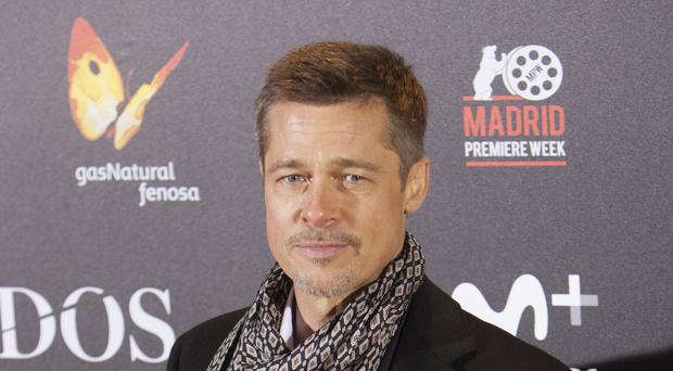 Brad Pitt in Madrid for the Spanish premiere of his new film Allied, as the FBI said he will face no charges over an alleged altercation with his adopted son (AP)