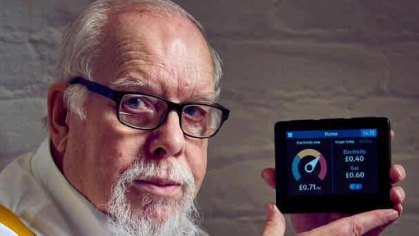 Sir Peter Blake holding a smart meter