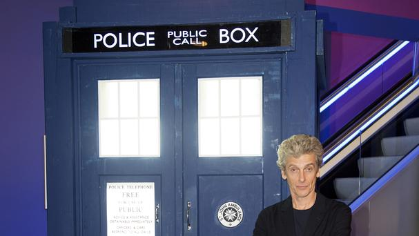 Actor Peter Capaldi, who plays Doctor Who, next to the Tardis