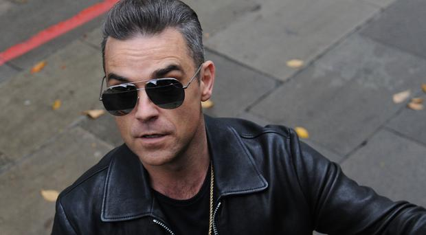 Robbie Williams has been crowned the most successful British solo act in official chart history