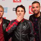 Dominic Howard, Matt Bellamy and Chris Wolstenholme of Muse