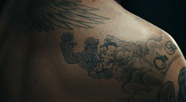 Scenes of violence against children appearing as animated tattoos on Unicef Goodwill Ambassador David Beckham (Unicef/PA)