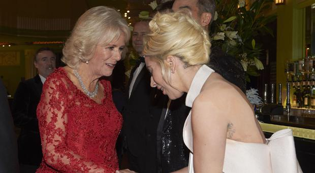 The Duchess of Cornwall is greeted by singer Lady Gaga at the Hammersmith Apollo
