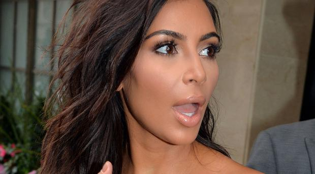 Queen's University Belfast issued online advice to women that they should not dress like US reality TV star Kim Kardashian during their graduation