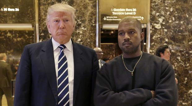 President-elect Donald Trump and Kanye West pose for a picture in the lobby of Trump Tower in New York. (AP)