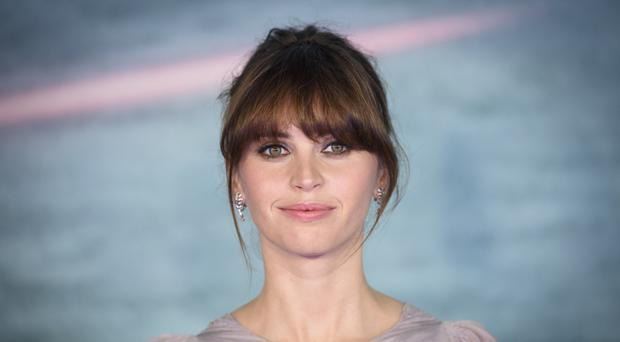 Felicity Jones attending the Rogue One: A Star Wars Story Premiere, at the Tate Modern, London.