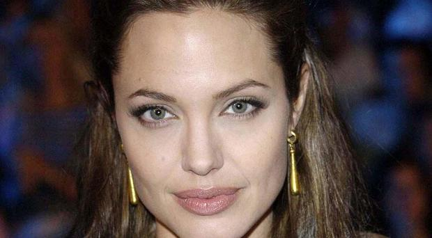 Angelina Jolie's double masectomy encouraged more women to be tested, research has found