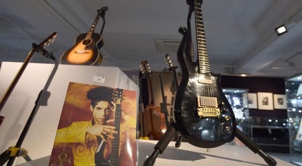 Guitars owned by Prince, right, and Jimi Hendrix sold at Bonhams