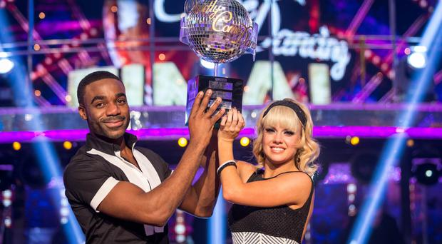 For use in UK, Ireland or Benelux countries only BBC handout photo of Joanne Clifton and Ore Oduba with the glitterball trophy after they won the final of the BBC1 show, Strictly Come Dancing.