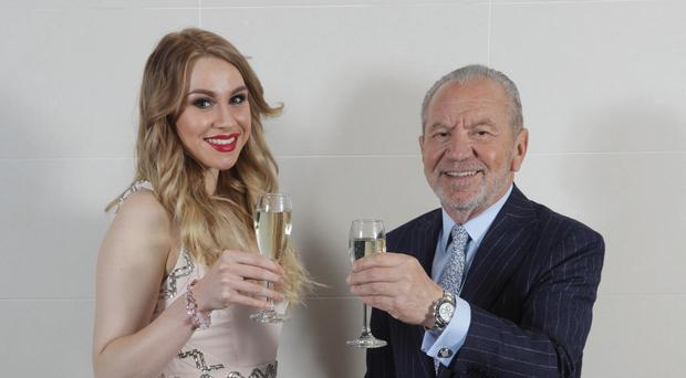 Alana Spencer toasts her Apprentice win with Lord Sugar