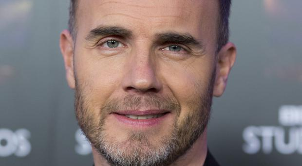 Gary Barlow joined Dannii Minogue and Martin Kemp to sing on Alan Carr's show - while wearing massive mouthguards