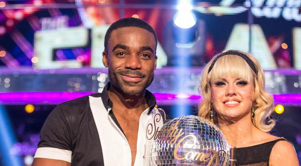 Ore Oduba and Joanne Clifton with the glitterball trophy after they won the 2016 series of Strictly Come Dancing (BBC/PA)