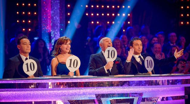 Len Goodman, second right, has quit has Strictly's head judge