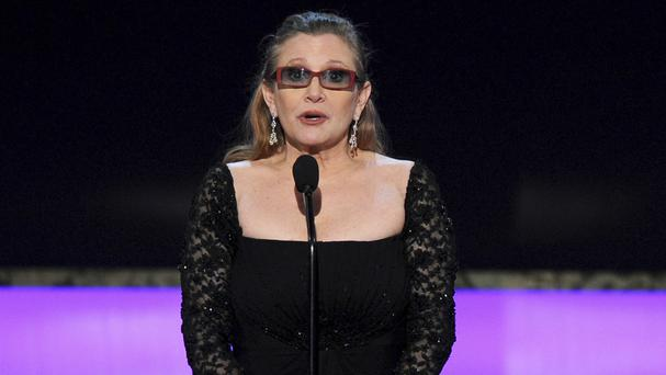 Carrie Fisher pictured in January 2015 presenting the life achievement award on stage at the 21st annual Screen Actors Guild Awards in Los Angeles (Vince Bucci/AP)