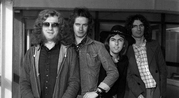 Guitarist Dave Hill, second from right, was one of the two original members of '70s band Slade