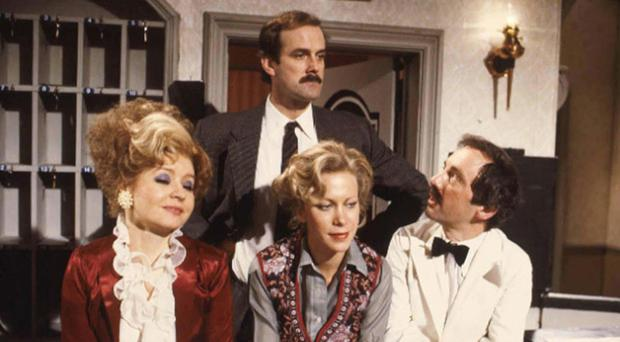 The cast of Fawlty Towers, which has been voted the funniest sitcom ever by a group of 100 comics (BBC/PA)