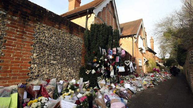Floral tributes outside George Michael's homes