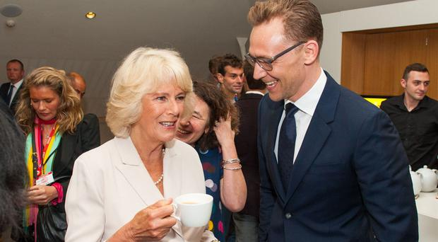 The Duchess of Cornwall with actor Tom Hiddleston after the live broadcast of the final of the 500 Words creative writing competition