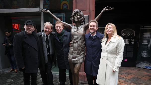 Artist Andy Edwards with Cilla Black's sons Ben, Jack and Robert Willis and artist Emma Rodgers by the statue of the singer at its unveiling outside the Cavern Club in Liverpool