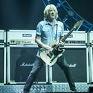 Rick Parfitt of Status Quo on stage at the Isle of Wight Festival last June - the guitarist's funeral will take place in Surrey