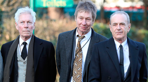 Status Quo members Andy Bown, John 'Rhino' Edwards and Francis Rossi arrive at Woking Crematorium for the funeral of guitarist Rick Parfitt (inset). Top: Rick's wife Lyndsay Whitburn after the service, and (above) former Quo drummer John Coghlan
