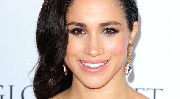 Meghan Markle plays paralegal Rachel Zane in TV legal drama Suits