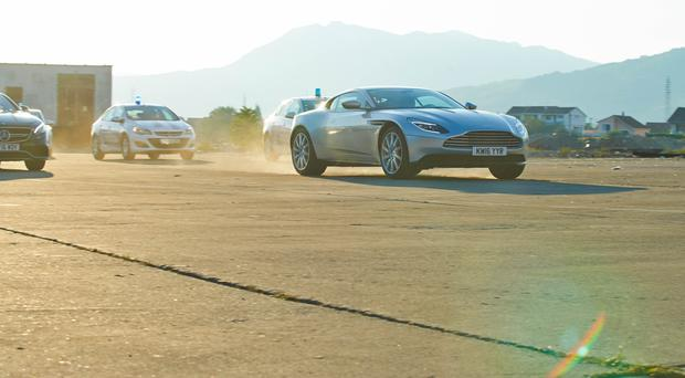 Matt LeBlanc driving an Aston Martin DB11 being pursued by police in Montenegro, during the the latest series of Top Gear (BBC/PA)