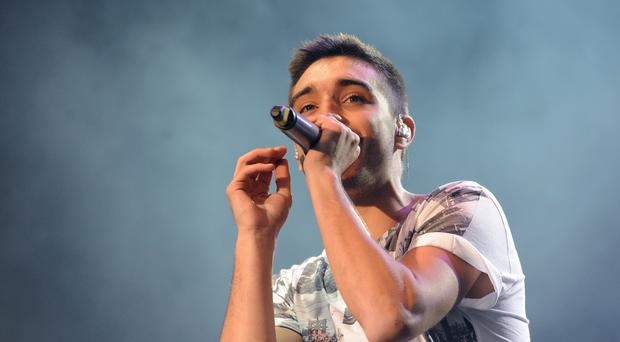 Tom Parker of The Wanted has put his wedding on hold