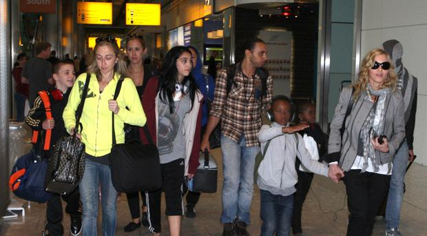 Madonna in a 2011 photo at Heathrow Airport