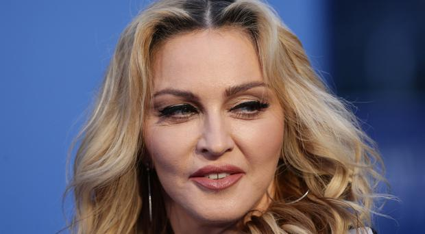 Madonna was granted permission to adopt twin girls from Malawi