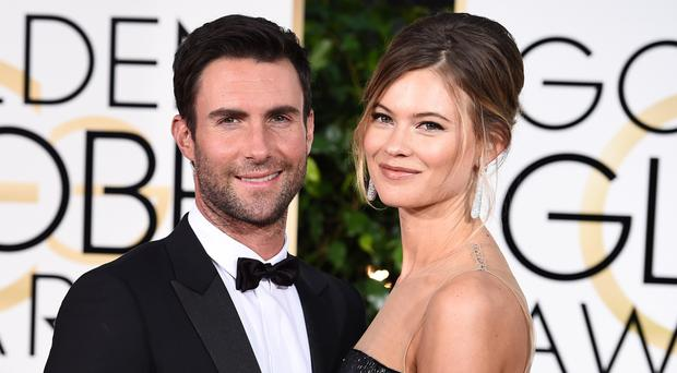 Adam Levine with his wife Behati Prinsloo.